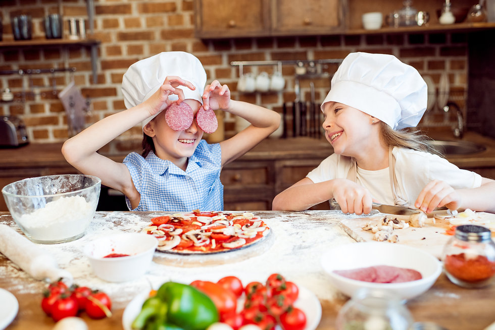 kids in chef hats having fun while makin