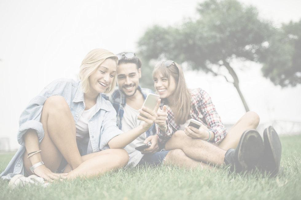 Friends%20Looking%20at%20App_edited.jpg