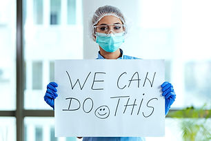 Healthcare%20worker%20holding%20placard%
