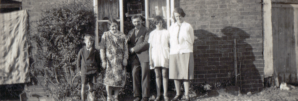 A Gubbins Family group outside Abbott Brothers baker's shop