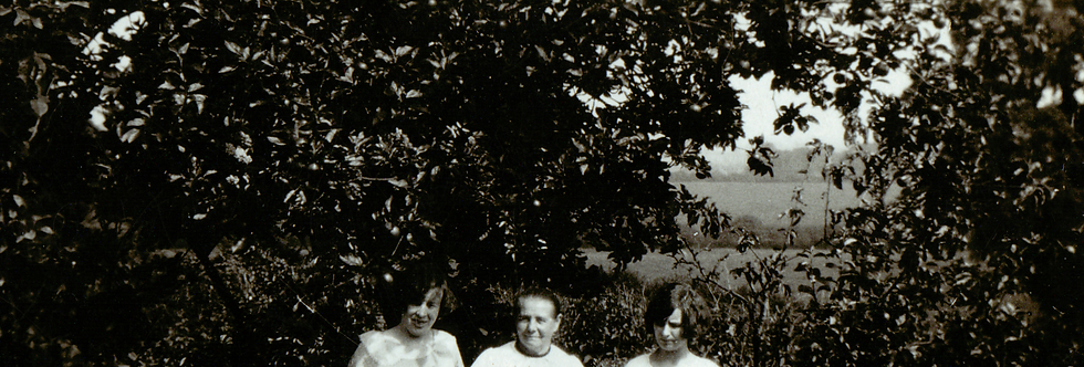 Three ladies of the Gubbins family in their garden at Eydon