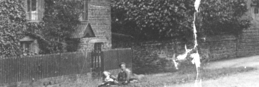 Detail of Children in KL273 - Sitting outside Cross Tree Cottages