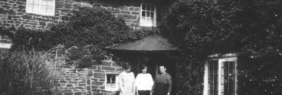 Three Gubbins ladies outside their front door