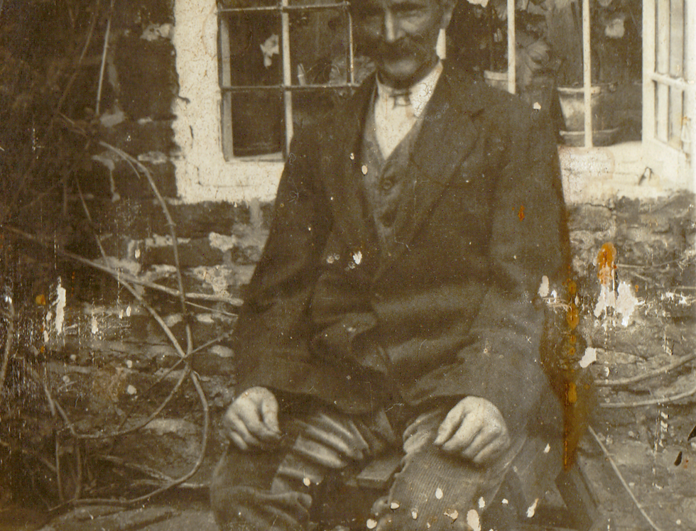 Alf Gubbins sitting outside his cottage near The Green at Eydon