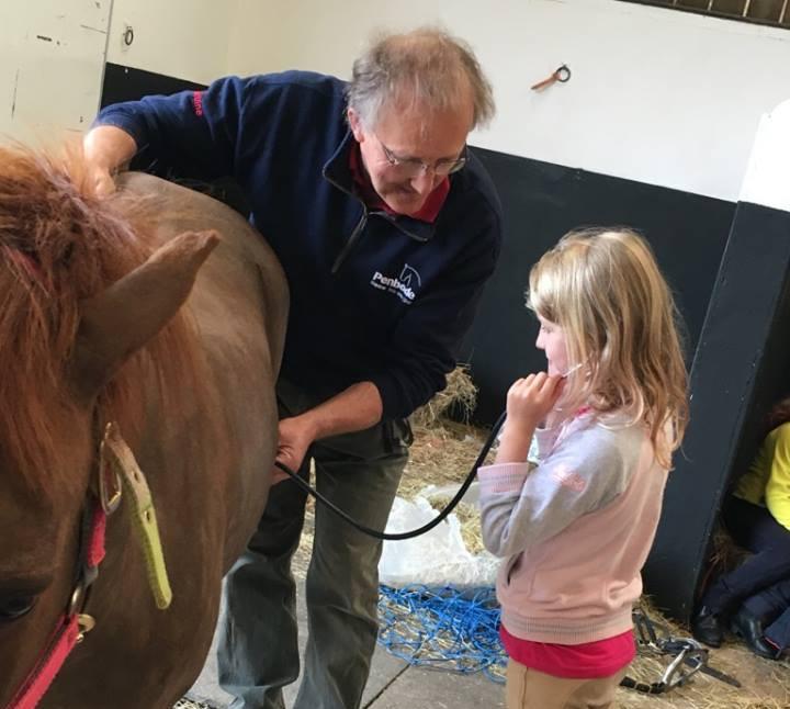 Kieran with a young Pony Club member