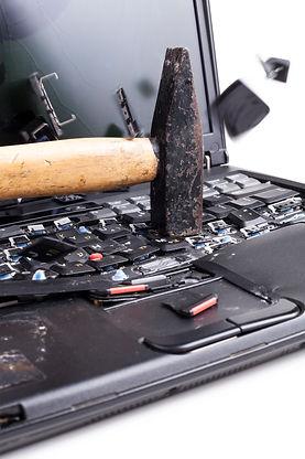 smashing-the-laptop-5QGWYA9.jpg