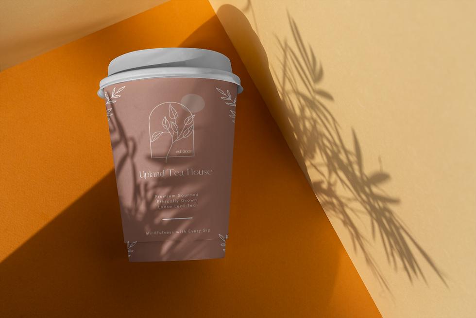 elegant-mockup-of-a-coffee-cup-under-a-shadow-3772-el1.png