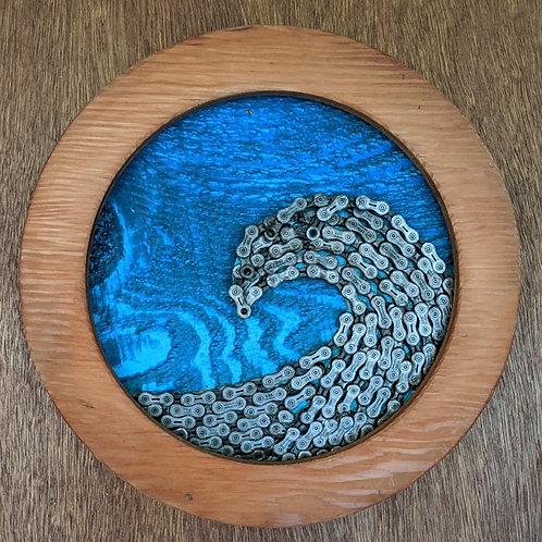 wave of recycled materials bike spokes bicycle chain art round puzzle bike rim blue skies sunset