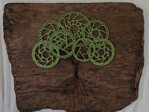 Recycled materials art tree disc brakes driftwood green growth adrift