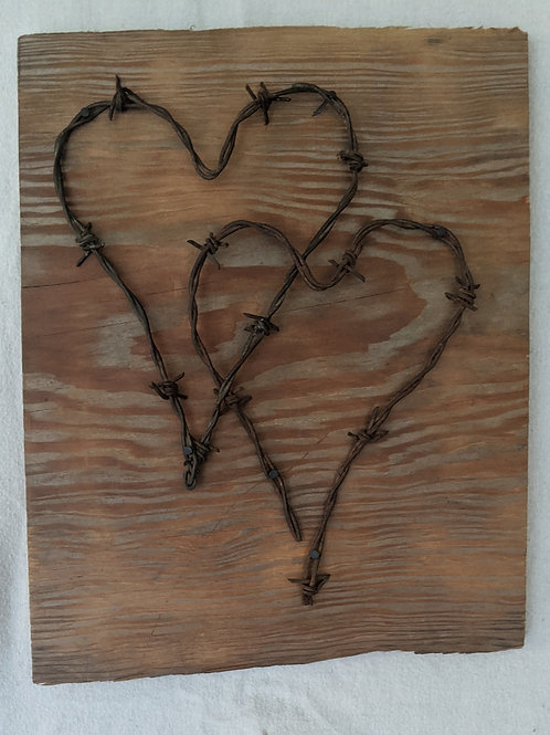 recycled materials art barbed wire hearts intertwined love couples