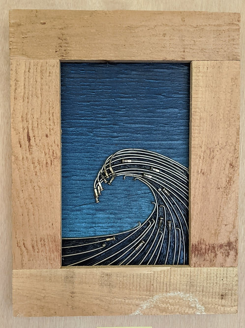 wave of recycled materials bike spokes bicycle chain wire scrap wood cable recycled art  blue skies sunset