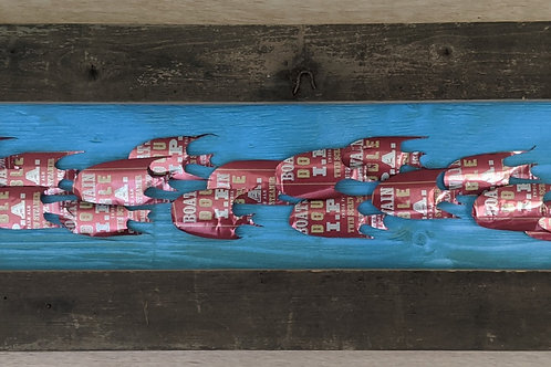 fish art made with recycled materials scrap fence wood frame beer cans boatswain