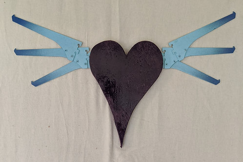 recycled materials art flying heart winged purple