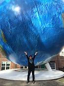 Andrea and the globe.jpg