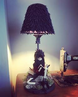 boy crow lamp