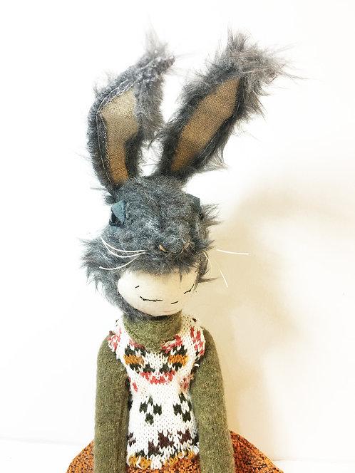 a wild grey Rabbit dressed a bit like a carrot.