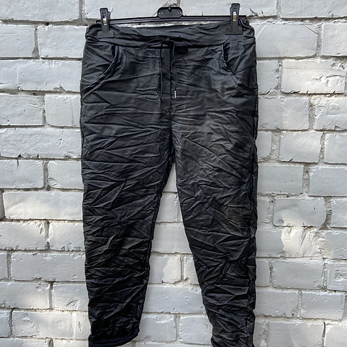 Black faux leather magic pants