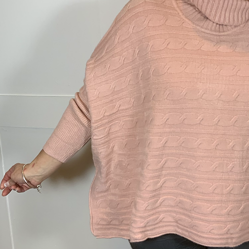 Pink cable roll neck jumper