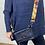 Thumbnail: Navy leather bag with orange camo strap.