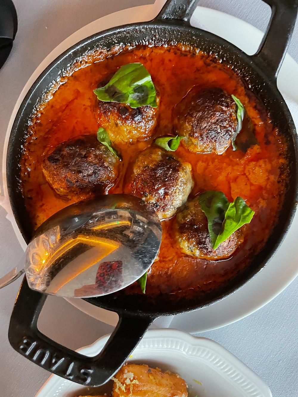 Signature meatballs in rich tomato sauce.