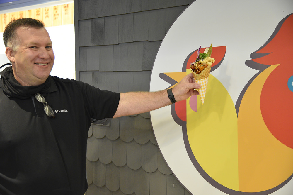 Buttercup: honey butter, lemon zest, chive, mac n' cheese poses with CEO Jack Gibbons.