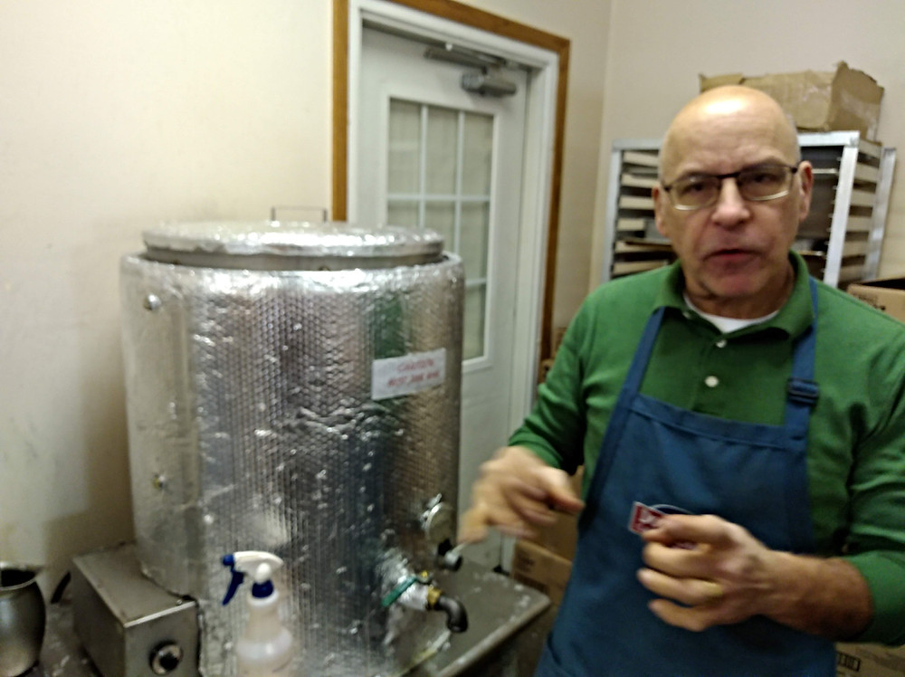 Mike Felhofer explains candle making.