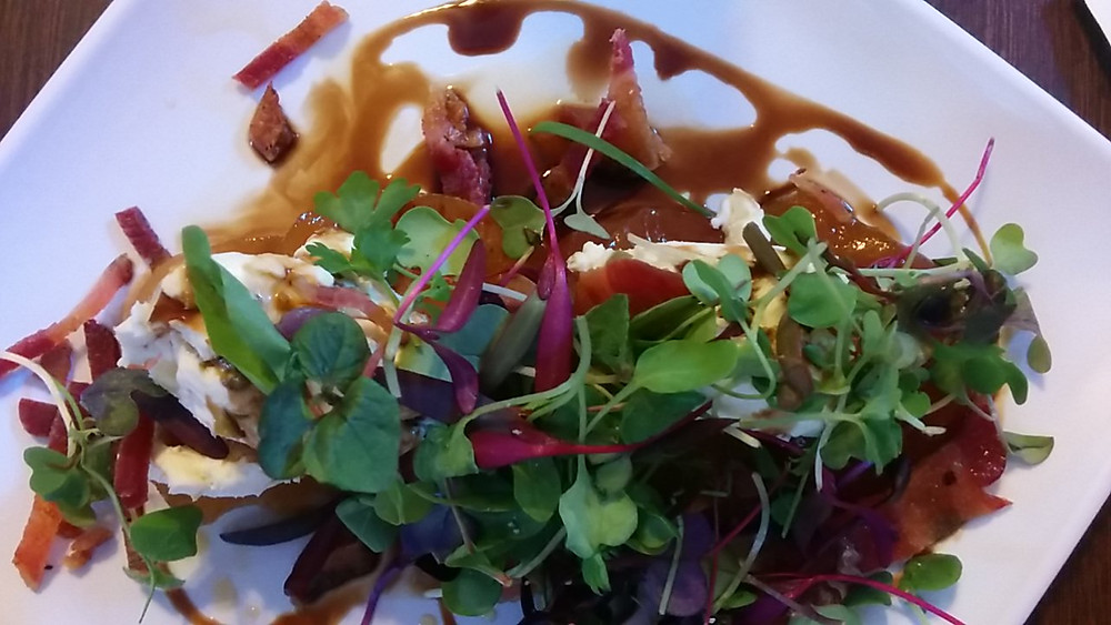 Amaya Meets The Pair: Poached pear salad topped with crispy bacon and jalapeño cream cheese