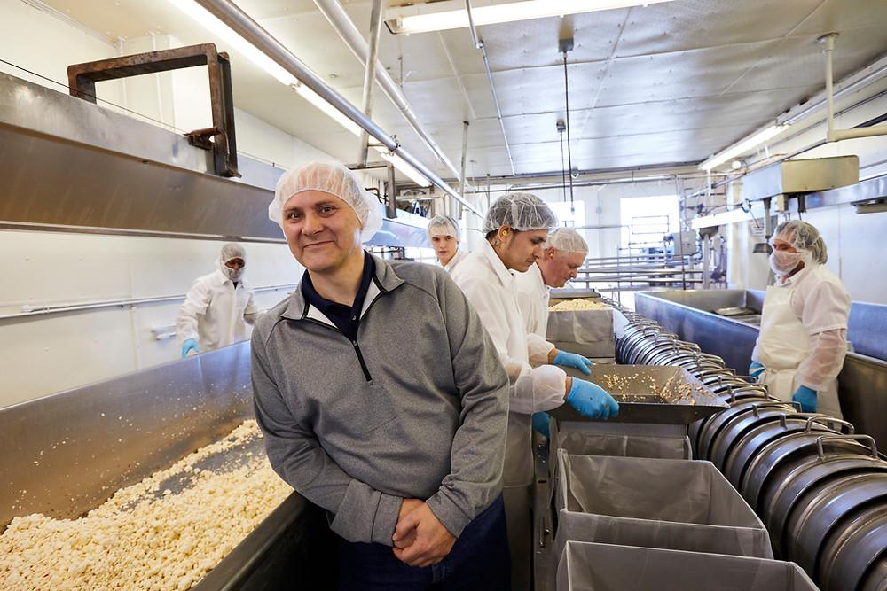 Chris Renard In Cheese Factory