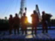 Oil field oil workers at work.jpg
