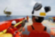 workers on transport boat to offshore ri