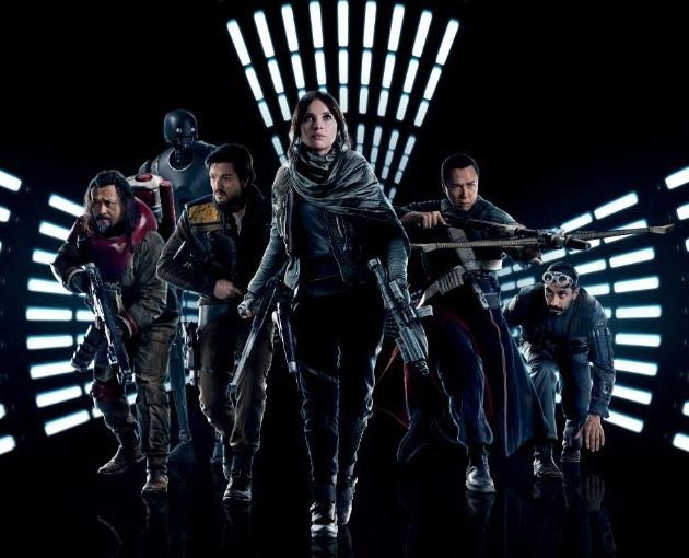 Characters from Rogue One: A Star Wars Story traverse through a dark corridor.