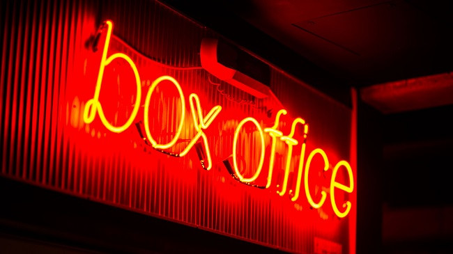 "Red, neon ""box office"" sign."