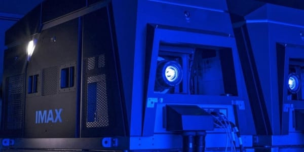 IMAX Laser Projectors fill a room with blue light.