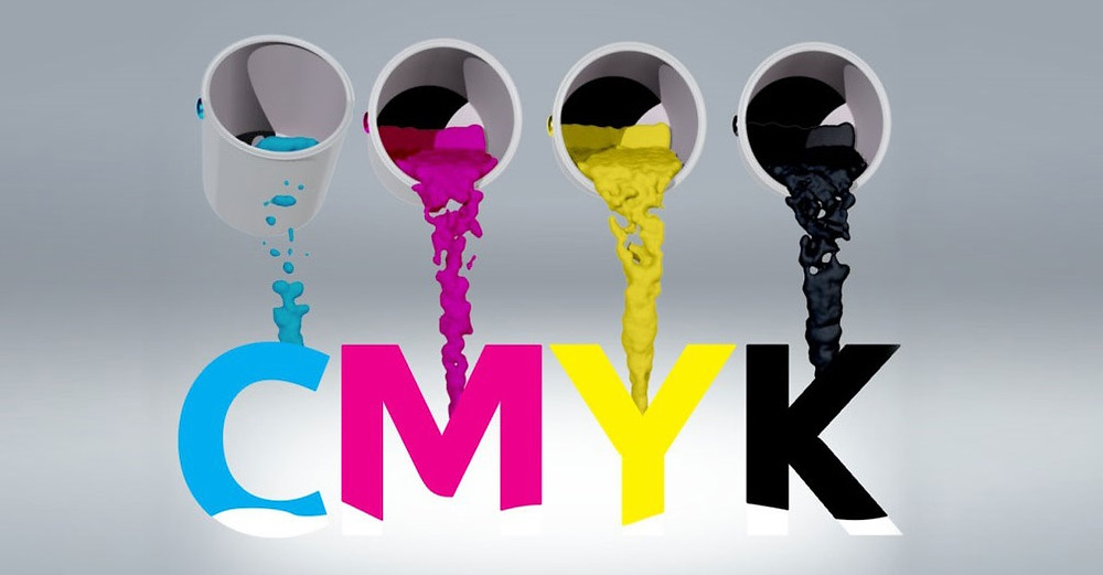 Cyan, magenta, yellow, and key colored buckets of paint.