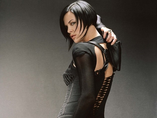 Aeon Flux reaches for a holster on her back.