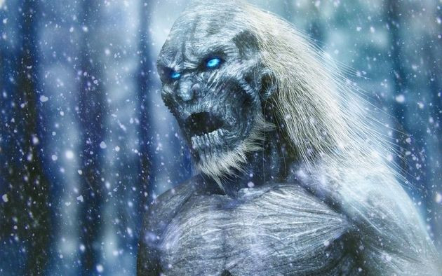 A White Walker from Game of Thrones looking menacing in a snowy forest.