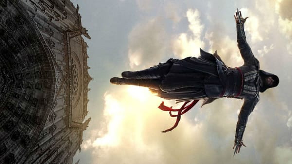 Callum Lynch of Assassin's Creed dives off the roof of a tower.