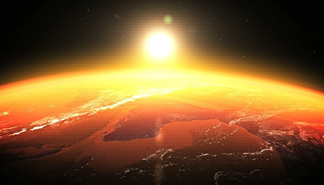 The sun rising in space over an orange Earth.