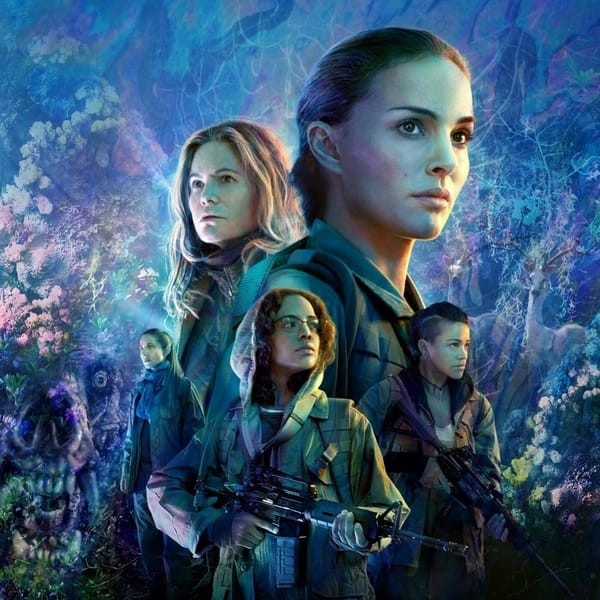 Annihilation's cast posing before colorful mutated wildlife.