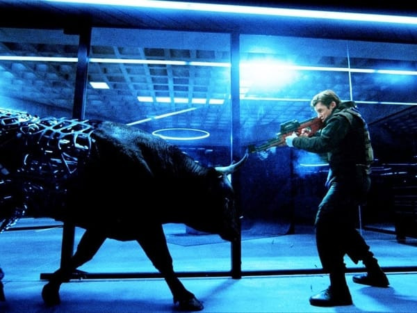 A robotic bull charges toward a Westworld security guard.