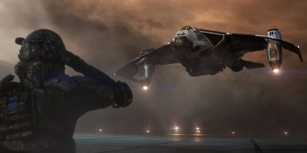 """The futuristic dropship """"Lucky 13"""" inverts its engines and prepares to land atop a foggy runway."""