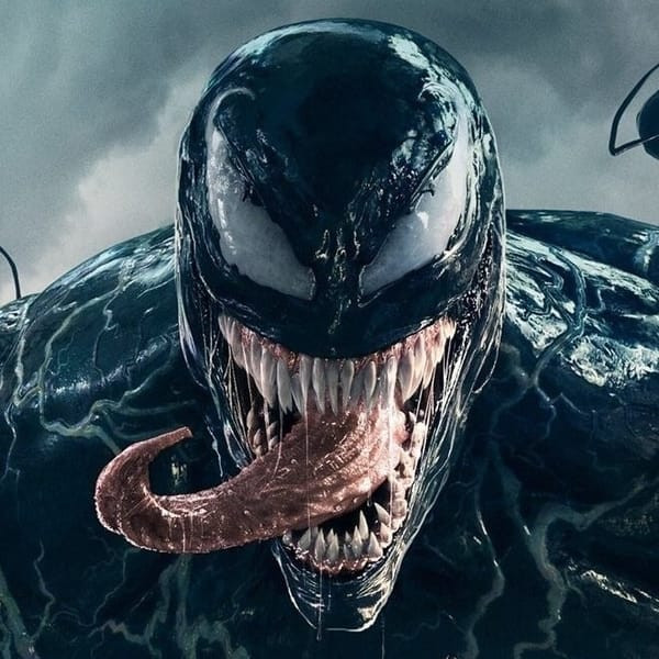 Venom's face looks slimy as he sticks his tongue out before a cloudy background.