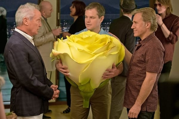 Paul buys a life-sized yellow rose from a specialty shop.