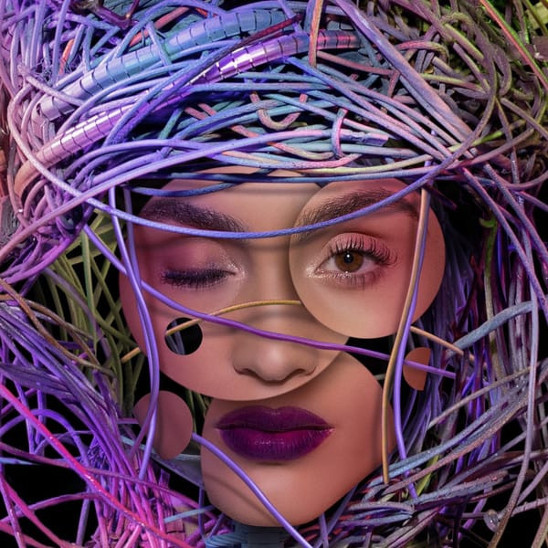 A robotic woman's face surrounded by cords and cables.