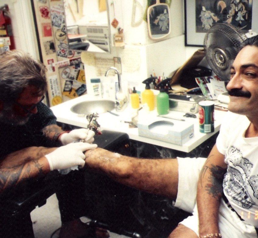 Mike Mallow tattooing Lou Sciberras