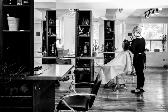 EMPIRE BARBERING & BEAUTY CO