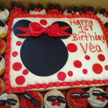 Minnie Mouse Sheet cake with matching Cupcakes