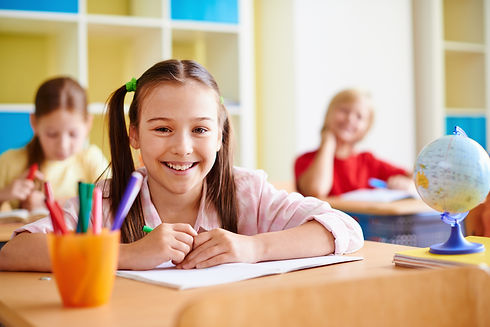 girl-with-big-smile-in-classroom.jpg