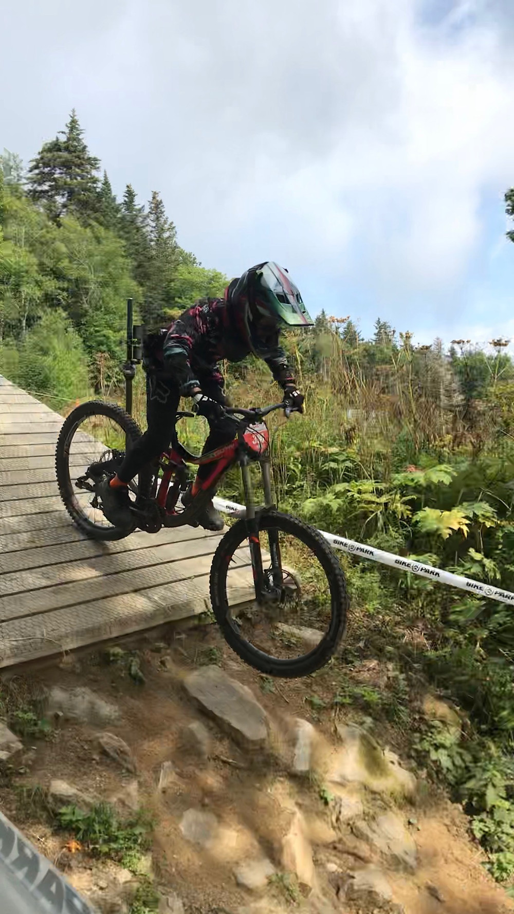 Photo by Jason DiDomenico. KMS Downhill MTB team member Gabe Johnson drops in at the start of the Killington Eastern Cup Race Aug. 3, 2019.