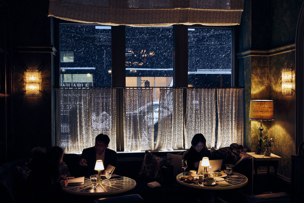 USA / New York City / 07.03.2018 / Inside the Beekman Hotel while a snowstorm is raging outside.